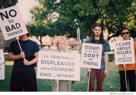 canadian-protest-signs